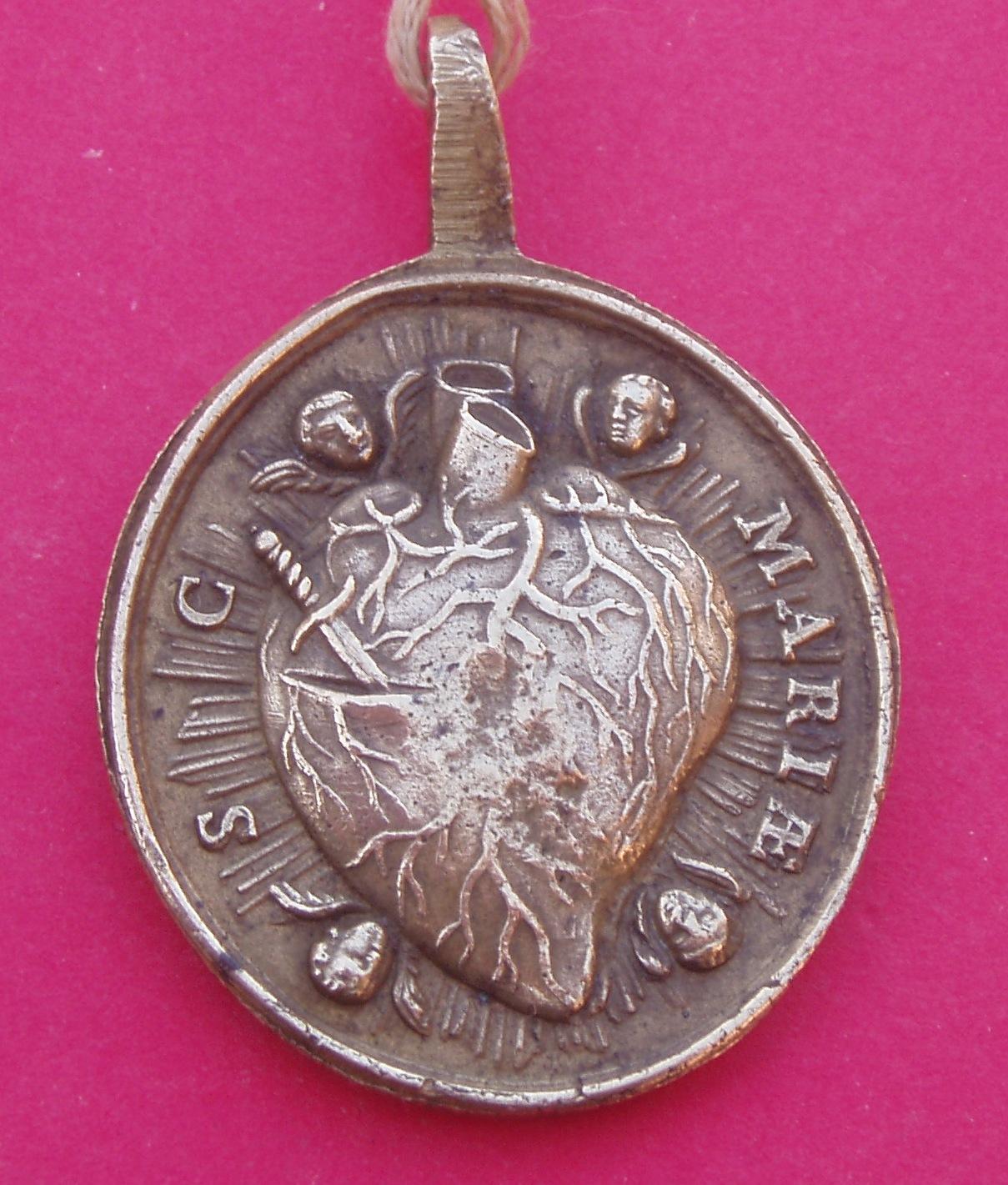 Medalla Corazónes de jesús y María. Smglly