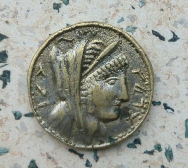 Moneda para identificar V8heuv