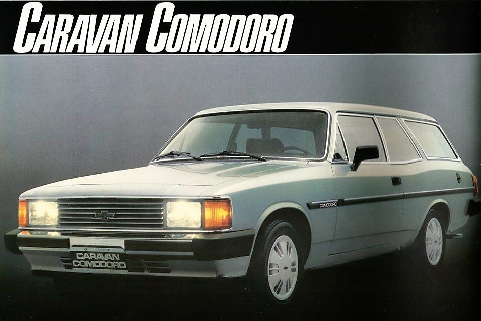 Propaganda Comodoro 1986 - Alguém tem? 25u2n43