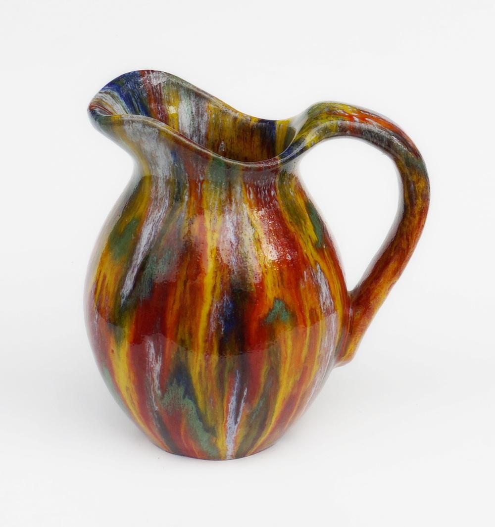 Anyone recognize the multi colored drip glaze Pottery Pitcher 2vkm2wz