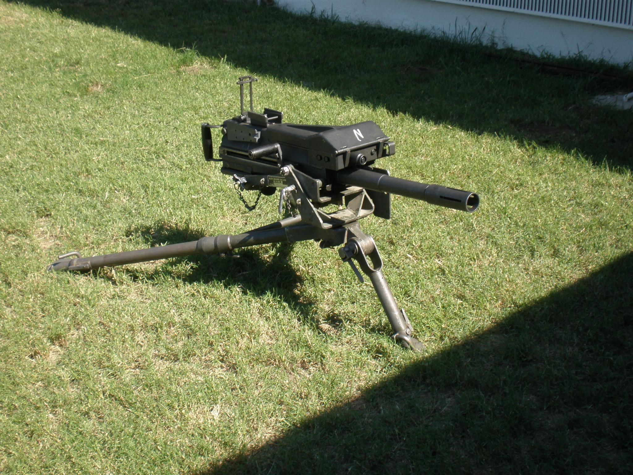 قاذف القنابل (الرمان) بأنواعها  Mk_19_grenade_launcher_by_darksamuraix1999