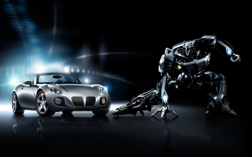 Pontiac Solstice Autobot_jazz_promo_poster__both_vehicle_and_robot_modes__446286_27892