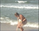 Family nudism. Naked nudists with their naked children.Dressed With A Smile 1054967-thumb