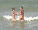Family nudism. Naked nudists with their naked children.Dressed With A Smile 1054972-thumb
