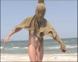 Family nudism. Naked nudists with their naked children.Dressed With A Smile 1054974-thumb