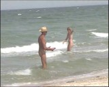 Family nudism. Naked nudists with their naked children.Dressed With A Smile 1054976-thumb