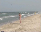 Family nudism. Naked nudists with their naked children.Dressed With A Smile 1054984-thumb