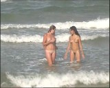 Family nudism. Naked nudists with their naked children.Dressed With A Smile 1054987-thumb
