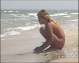 Family nudism. Naked nudists with their naked children.Dressed With A Smile 1054994-thumb