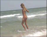 Family nudism. Naked nudists with their naked children.Dressed With A Smile 1054996-thumb