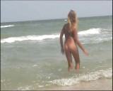 Family nudism. Naked nudists with their naked children.Dressed With A Smile 1054997-thumb