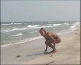 Family nudism. Naked nudists with their naked children.Dressed With A Smile 1054999-thumb