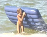 Family nudism. Naked nudists with their naked children.Dressed With A Smile 1055008-thumb