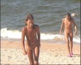 Family nudism. Naked nudists with their naked children.Dressed With A Smile 1055011-thumb