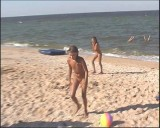 Family nudism. Naked nudists with their naked children.Dressed With A Smile 1055012-thumb