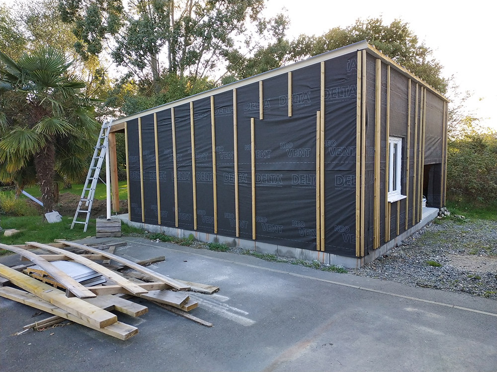 Construction d'un garage double en ossature bois - Page 5 Garage_24