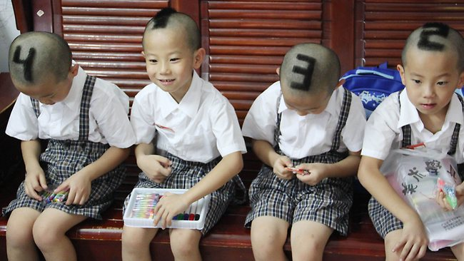 Humour du jour 458002-china-education-quadruplets-with-numbers-on-heads