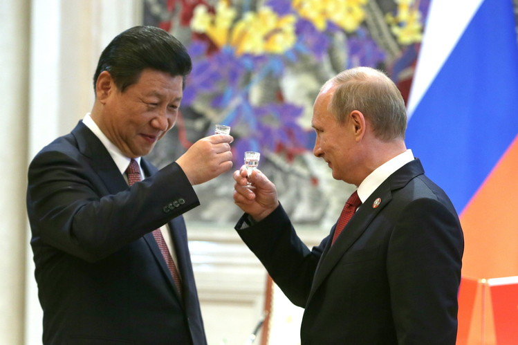 حصاد زيارة بوتين للصين .. حزمة من الاتفاقات بين الدولتين وشراكة طويلة الامد BN-EU285_0930cp_P_20140930164214