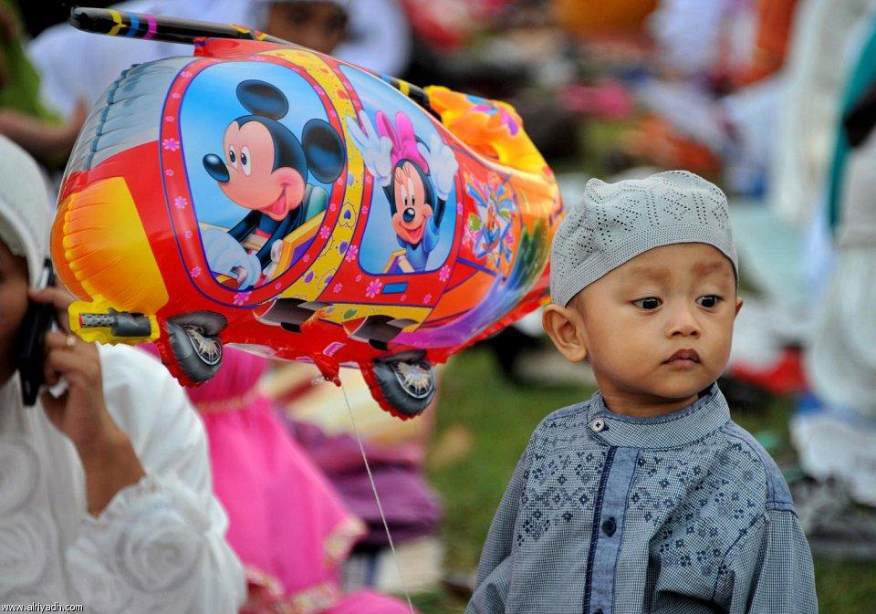 [صور]العيد فرحة لا حدود لها للأطفال المسلمين  1434 572451003593