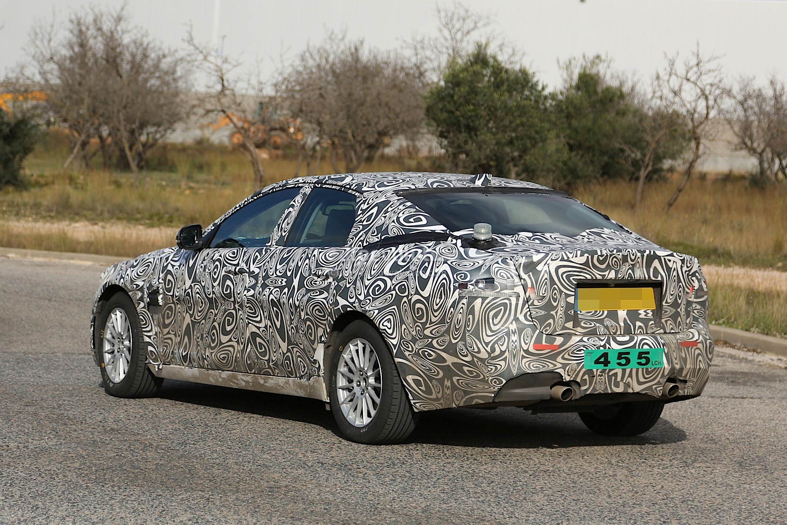 2016 - [Jaguar] XF II [X260] - Page 2 2015-jaguar-xf-spied-with-curious-looking-tail-pipes-photo-gallery_12