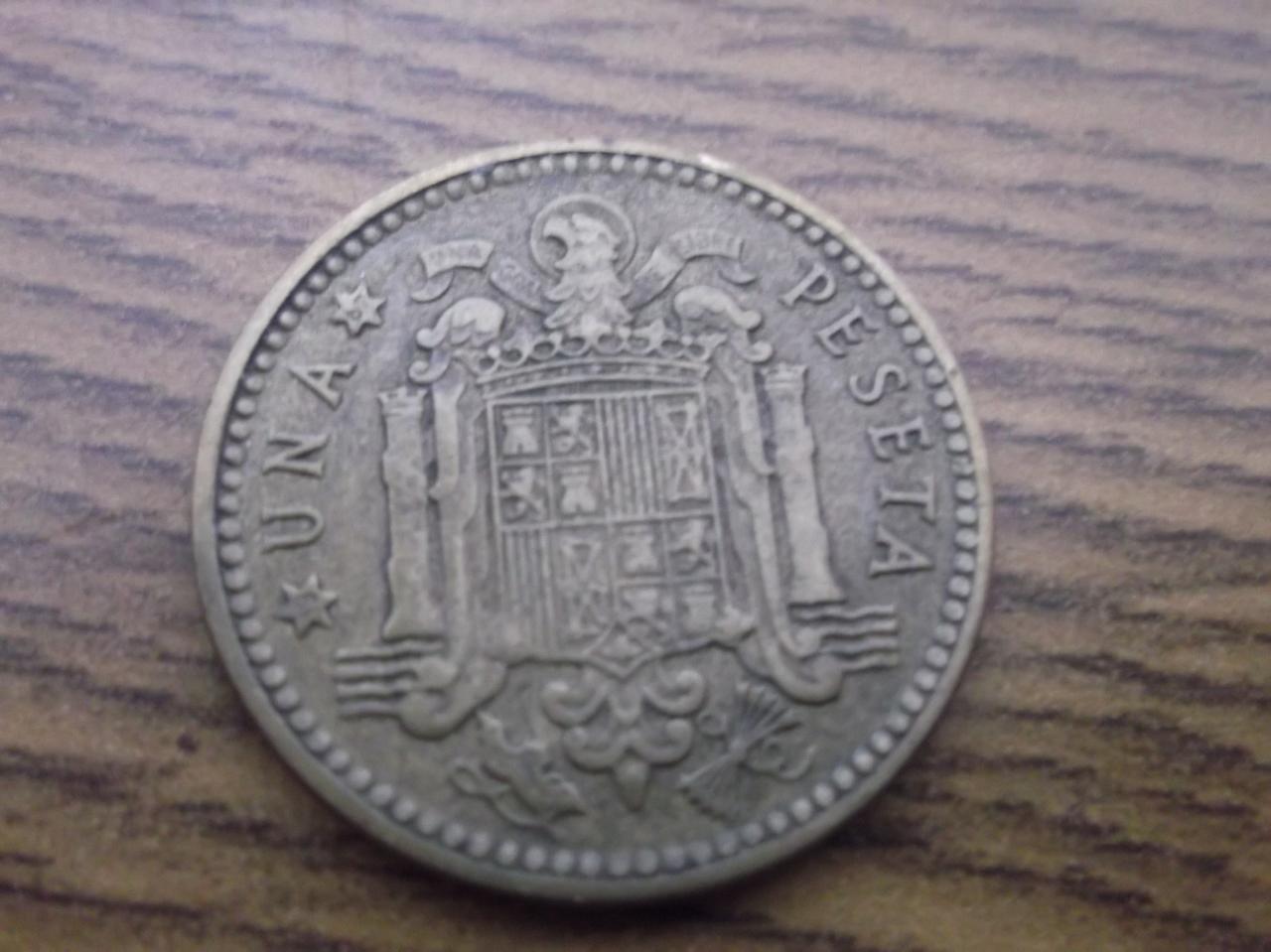 Algo raro en la peseta de 1963 estrella 67 DSCF3270