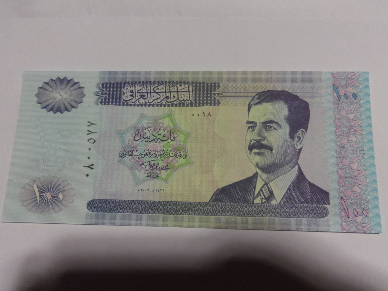 100 Dinares Irak, 2002 Sadam_anverso