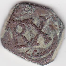 8 Maravedis de Felipe III o IV con reacuñación del anagrama a IIII maravedis de 1658-9, Coruña. Image