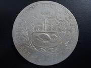 1 Liberty Dollar  1.967de Anguilla , sobre 1 Sol de Perú DSCN1338