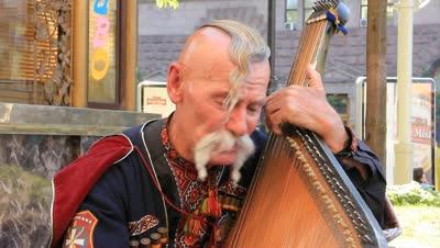 Célébration de Zaporozhye Cosaques, 17e siècle Musikant_3