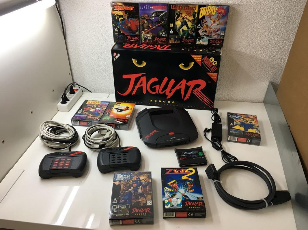[ESTIM rapide] Par curiosité lot Jaguar et jeux en boite en TBE Consoles-exotiques-atari-jaguar-und-10-games-in-ovp