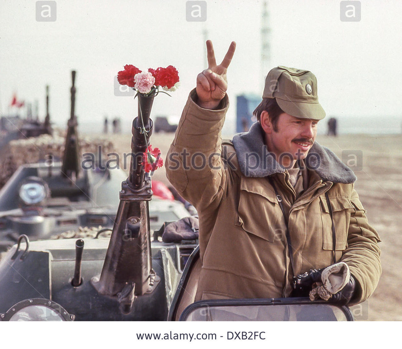 Soviet Afghanistan war - Page 5 Feb_16_1989_termez_uzbekistan_ru_standing_atop_a