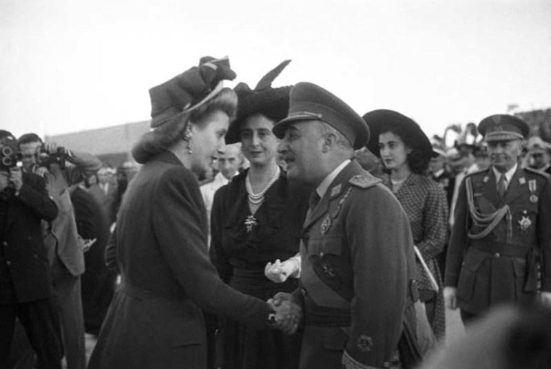 MONEDA DE 50 CENTIMOS DE 1949 PERFORADA ESTRELLA 51 Evita_y_los_Franco