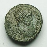 AE19 de Heliogábalo. LAVDICEON. Dos luchadores. Ceca Laodicea (Siria). Image
