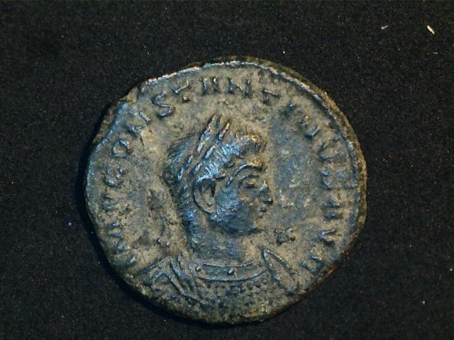 AE3 de Constantino I Magno. SOLI INVIC-TO COMITI. Sol radiado, estante a dcha. y mirando a  izq. Ceca Trier. 2016_12_16_0001_0_X