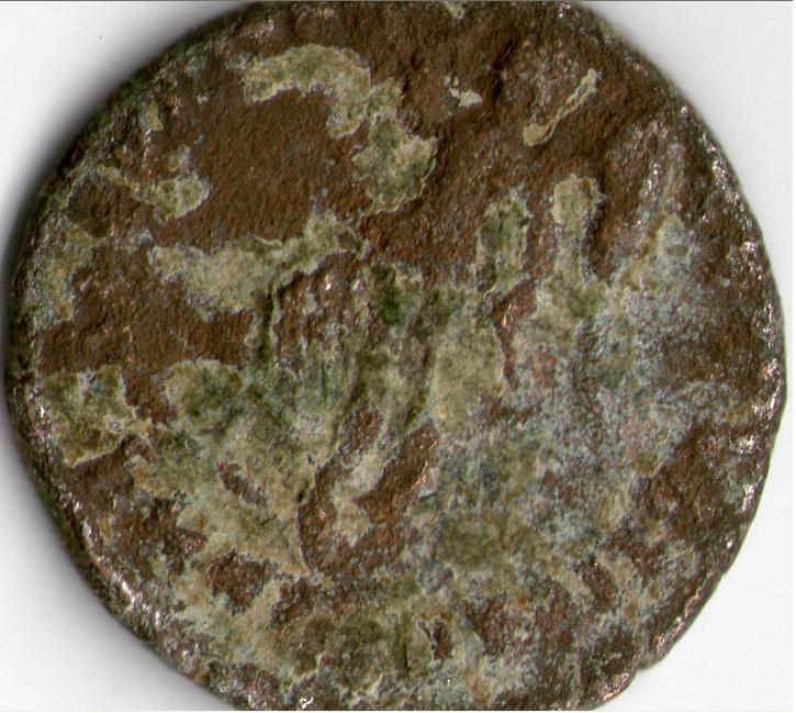¡Ayuda por favor! moneda romana Reverso