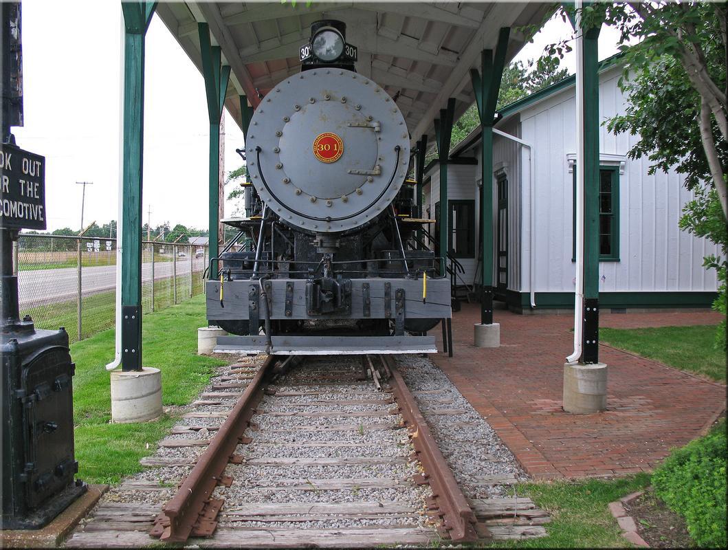 Frente al tren - manipulación fotográfica - incluídos stocks utilizados Western_reserve_village_16_by_wdwparksgal_stock