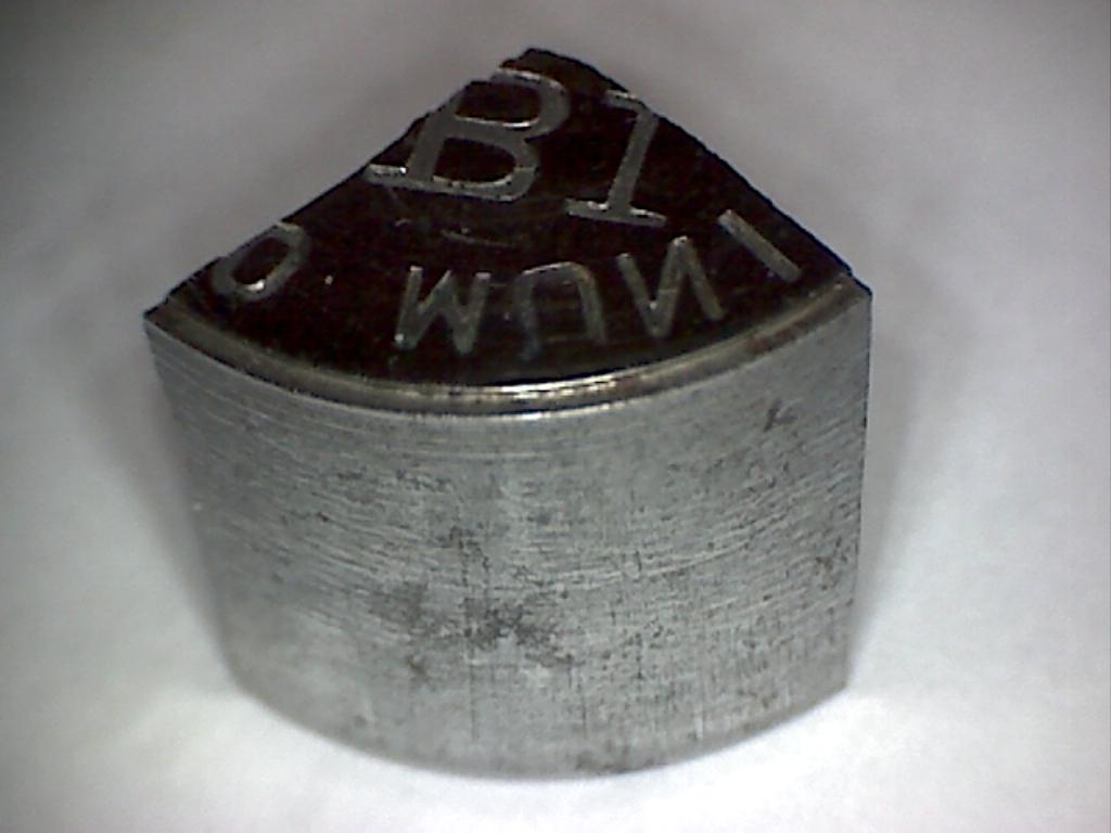 Fragmento de troquel usado para acuñar los 25 céntimos de Ibi Image