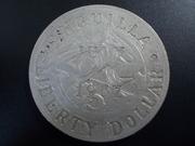 1 Liberty Dollar  1.967de Anguilla , sobre 1 Sol de Perú DSCN1337