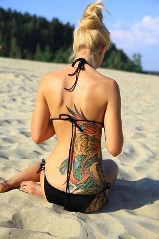 Ženska ledja... - Page 4 Zene_tetovaze_slike_ledja_na_tetovaze_najbolje_t