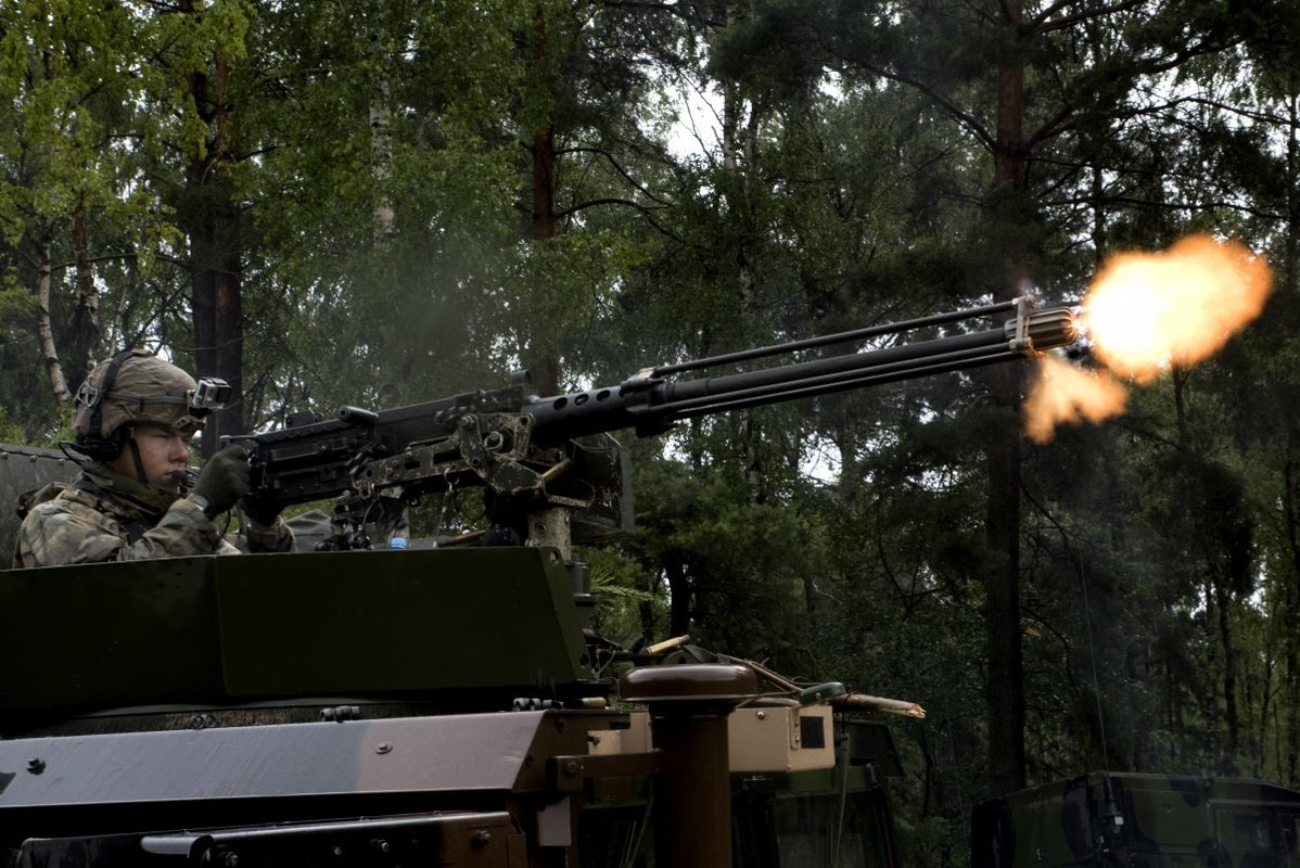 NATO/US Military Build up in Eastern Europe-Russian borders - Page 8 A_soldier_fires_a_50_caliber_machine_gun