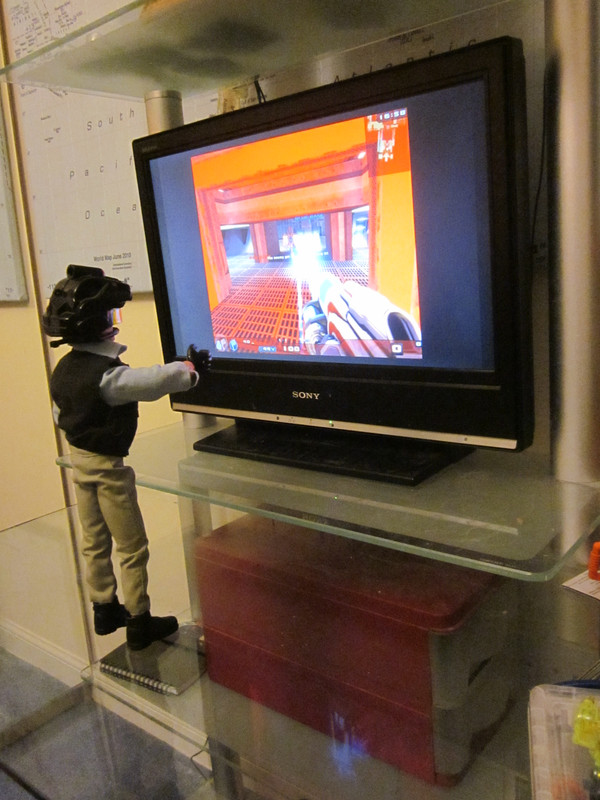 My Action Man playing a Virtual Reality shooting game. (Ackie88) IMG_2205