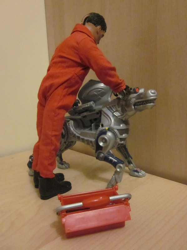 handyman fixing Robotic Dog IMG_2123