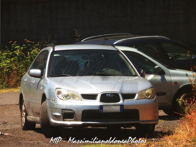 Avvistamenti auto rare non ancora d'epoca Subaru_Impreza_Compact_Wagon_R_AWD_1.5_105cv_08