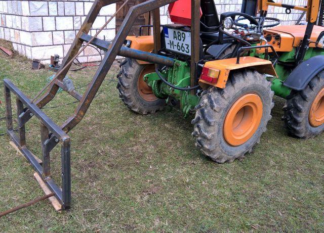 Zadnji traktorski utovarivač - Page 3 23425589