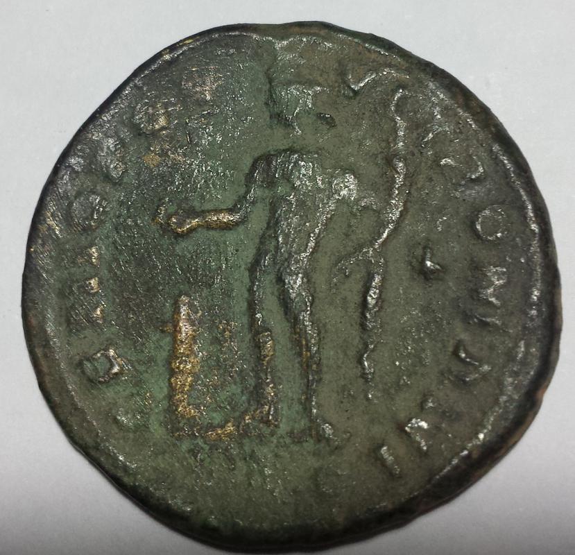Nummus de Diocleciano. GENIO POP-VLI ROMANI. Genio estante a izq. Lugdunum. Image