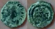 AE4 bajo imperio tipo VOT / XX / MVLT / XXX dentro de corona de laurel.  Image