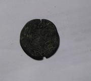 4 Maravedis de Felipe III resellados. Image
