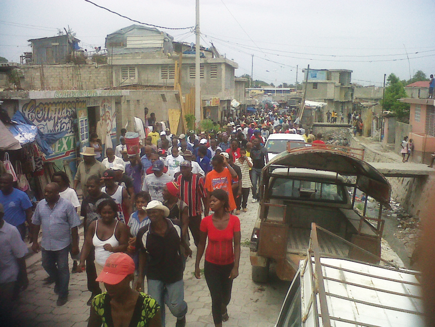 Haiti's constitutional horror show Haitians_march_in_Gonaives_against_Martelly_on_21st_anniv._of_1st_093091_coup_against_Aristide_093012-2