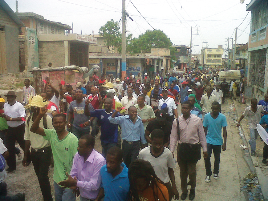 Haiti's constitutional horror show Haitians_march_in_Gonaives_against_Martelly_on_21st_anniv._of_1st_093091_coup_against_Aristide_093012-43