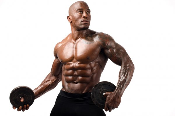Suoni e rumori Depositphotos_32287583-Black-bodybuilder-posing-with-round-discs.-Strong-man-with-perfect-abs-shouldersbiceps-triceps-and-chest.-Isolated-on-white-background